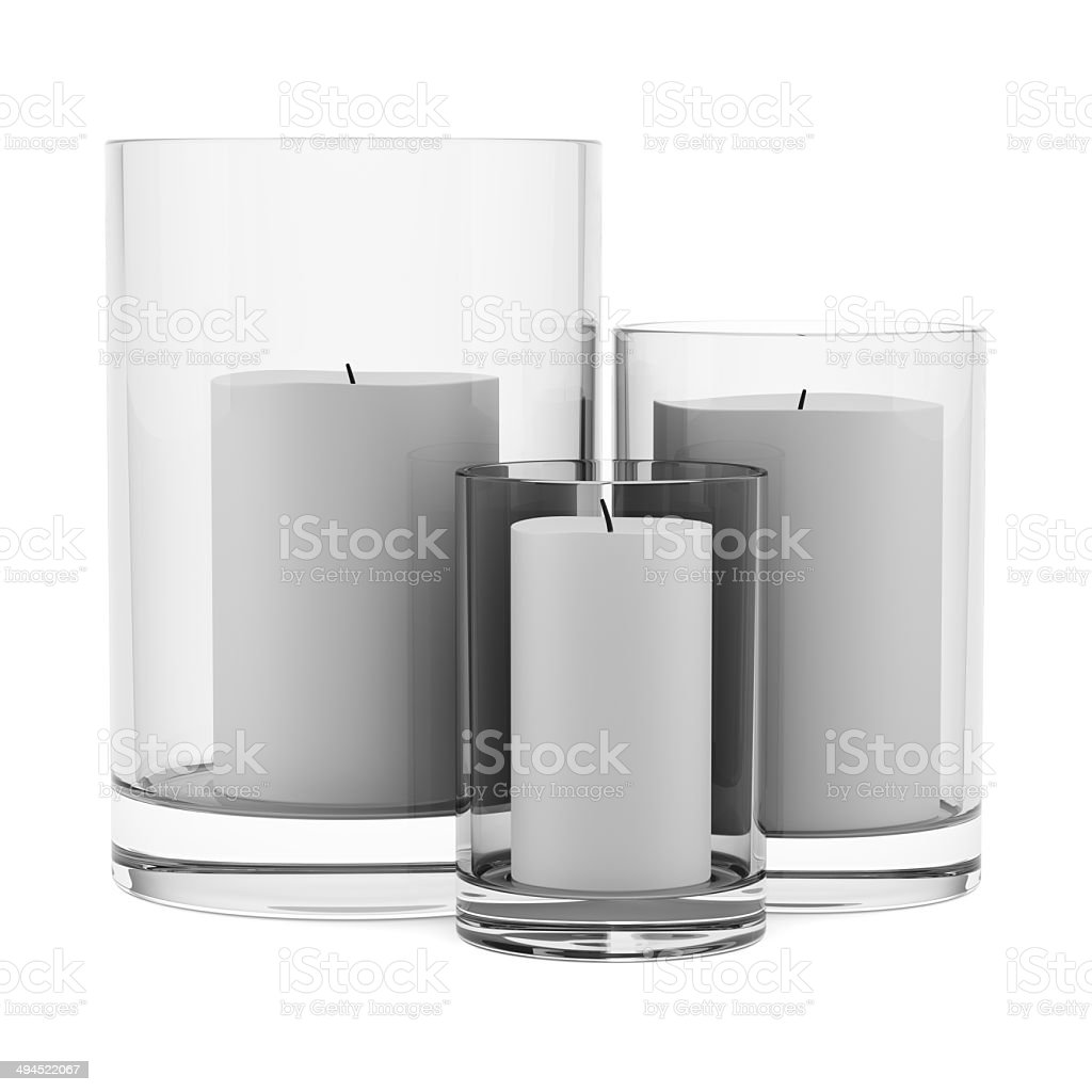 three glass candlesticks with candles isolated on white background stock photo