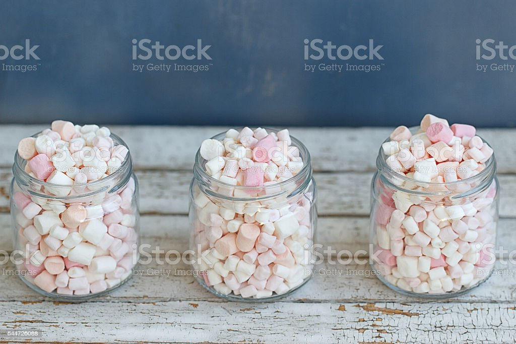 Three glass jars filled to brim marshmallow stock photo