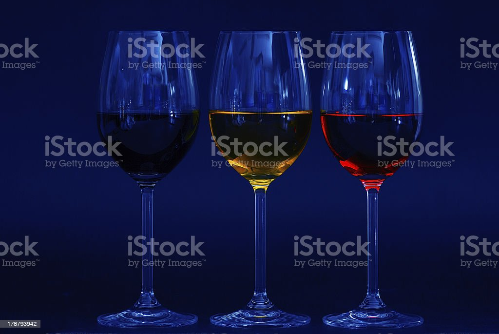 three glasses in blue royalty-free stock photo