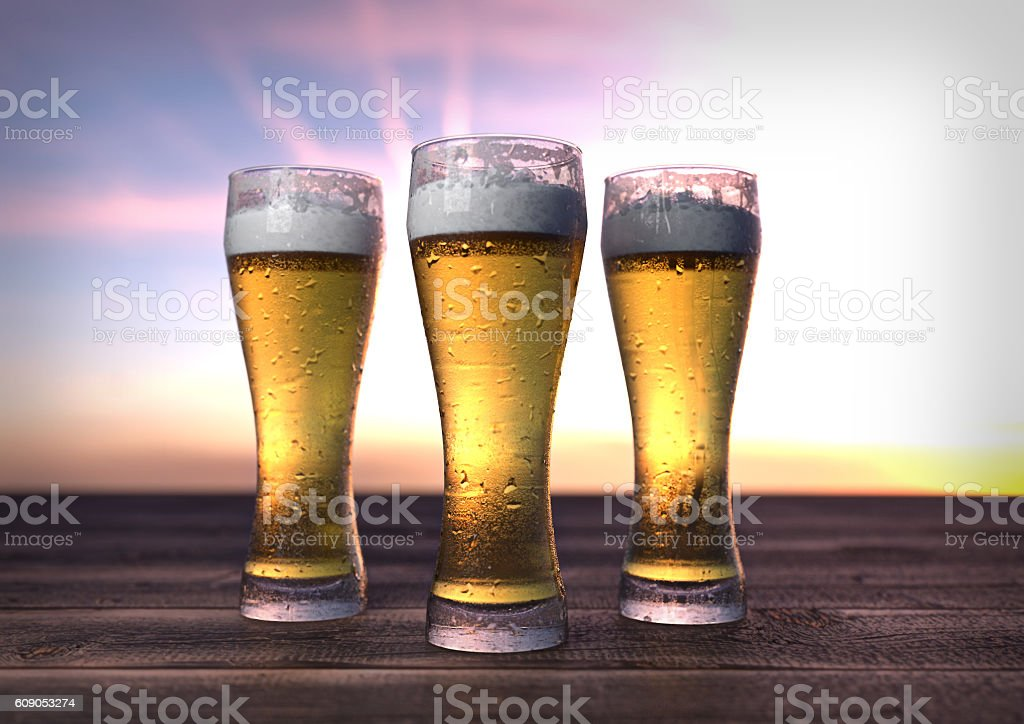 three glasses of beer on wooden desk. 3D render stock photo