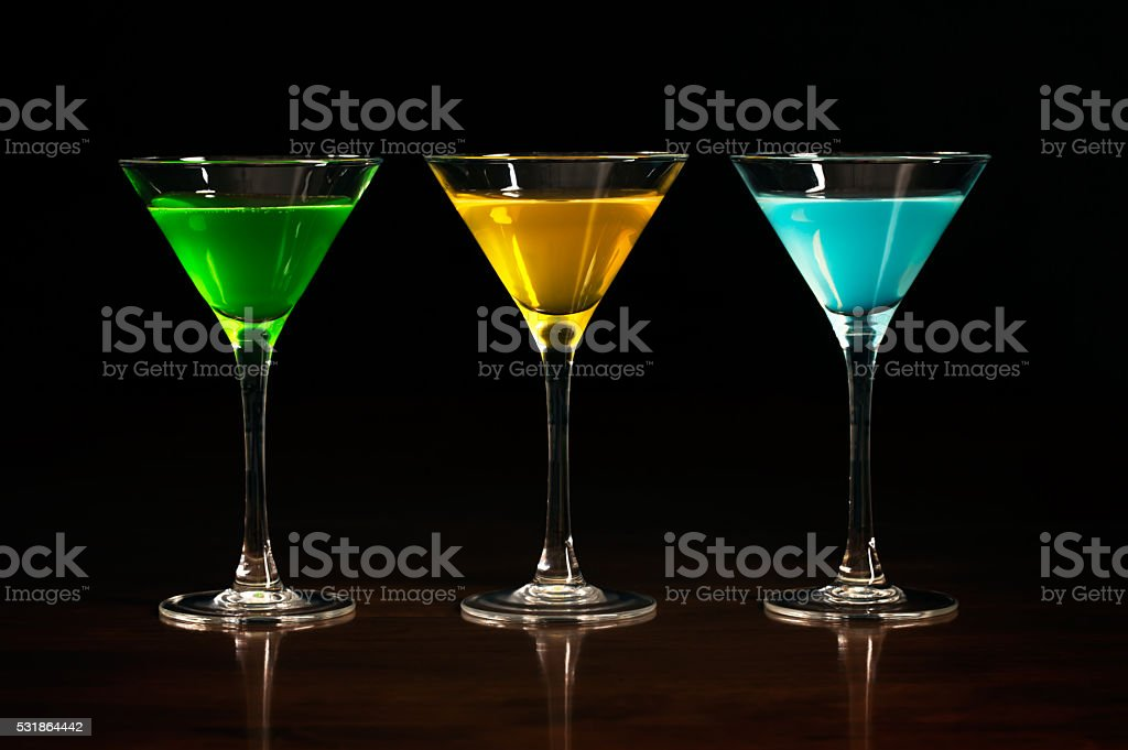 Three glasses of different alcohol cocktails stock photo