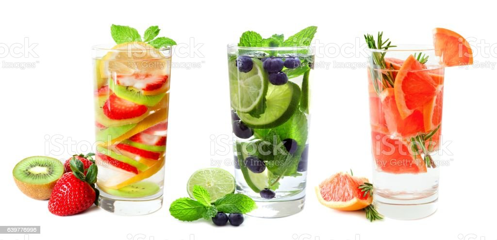 Three glasses of fruit infused water isolated on white stock photo