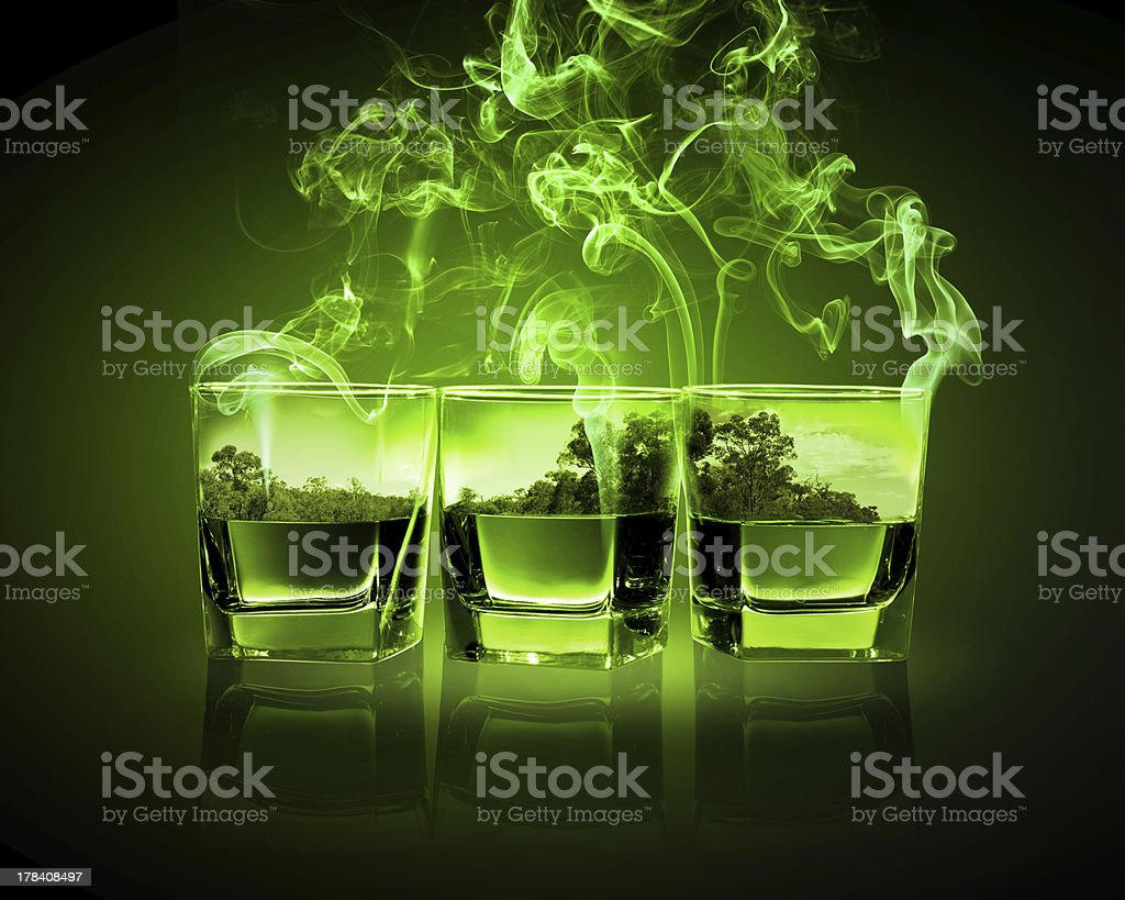 Three glasses of green absinth stock photo