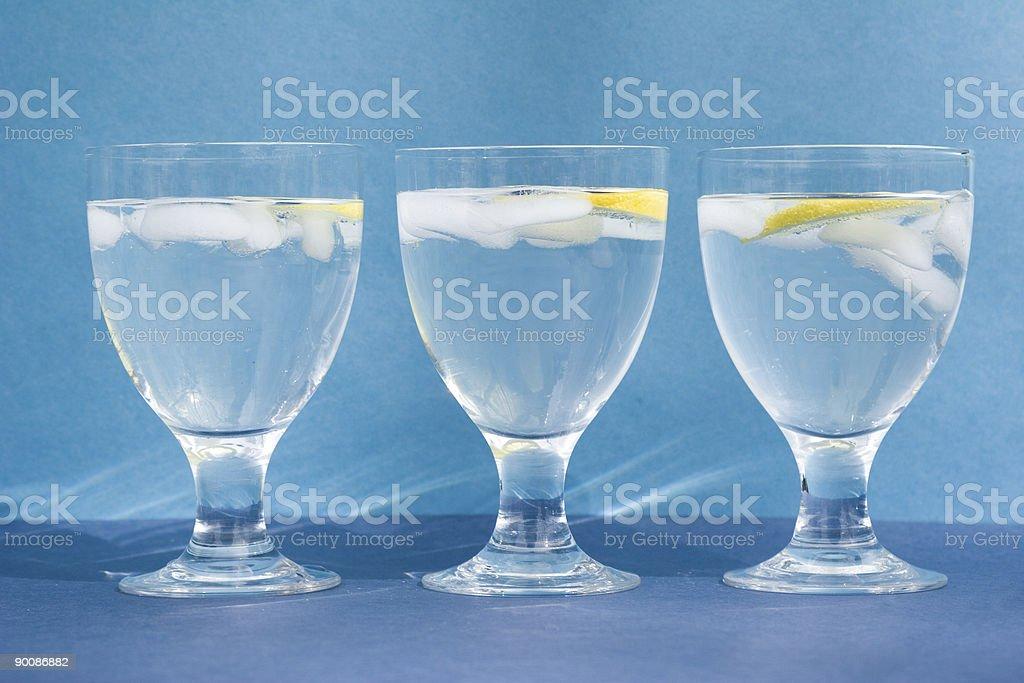 three glasses of ice water on aqua background royalty-free stock photo