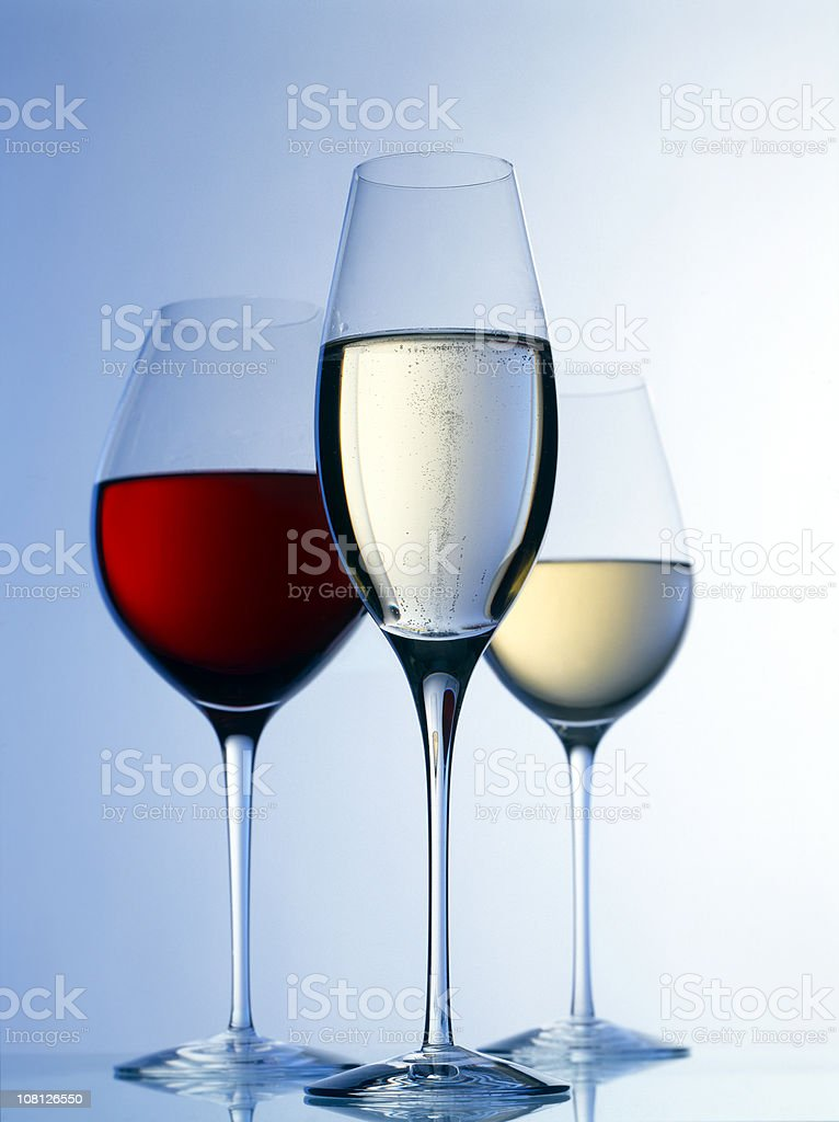 Three Glasses of Red Wine, White and Champagne royalty-free stock photo
