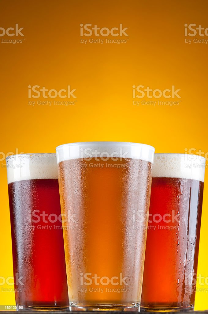 Three glasses of varying dark and light beers royalty-free stock photo