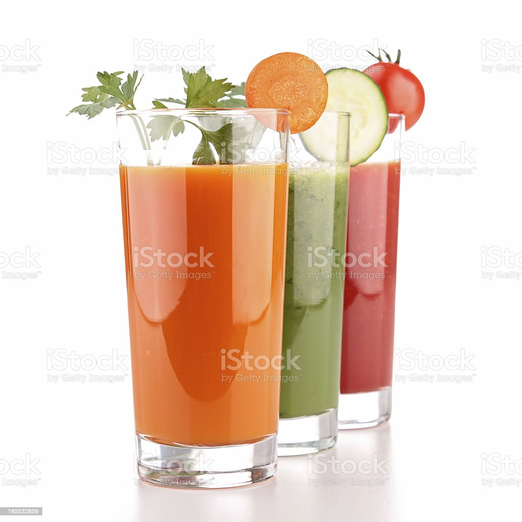 Three glasses of vegetable juice on a white background stock photo