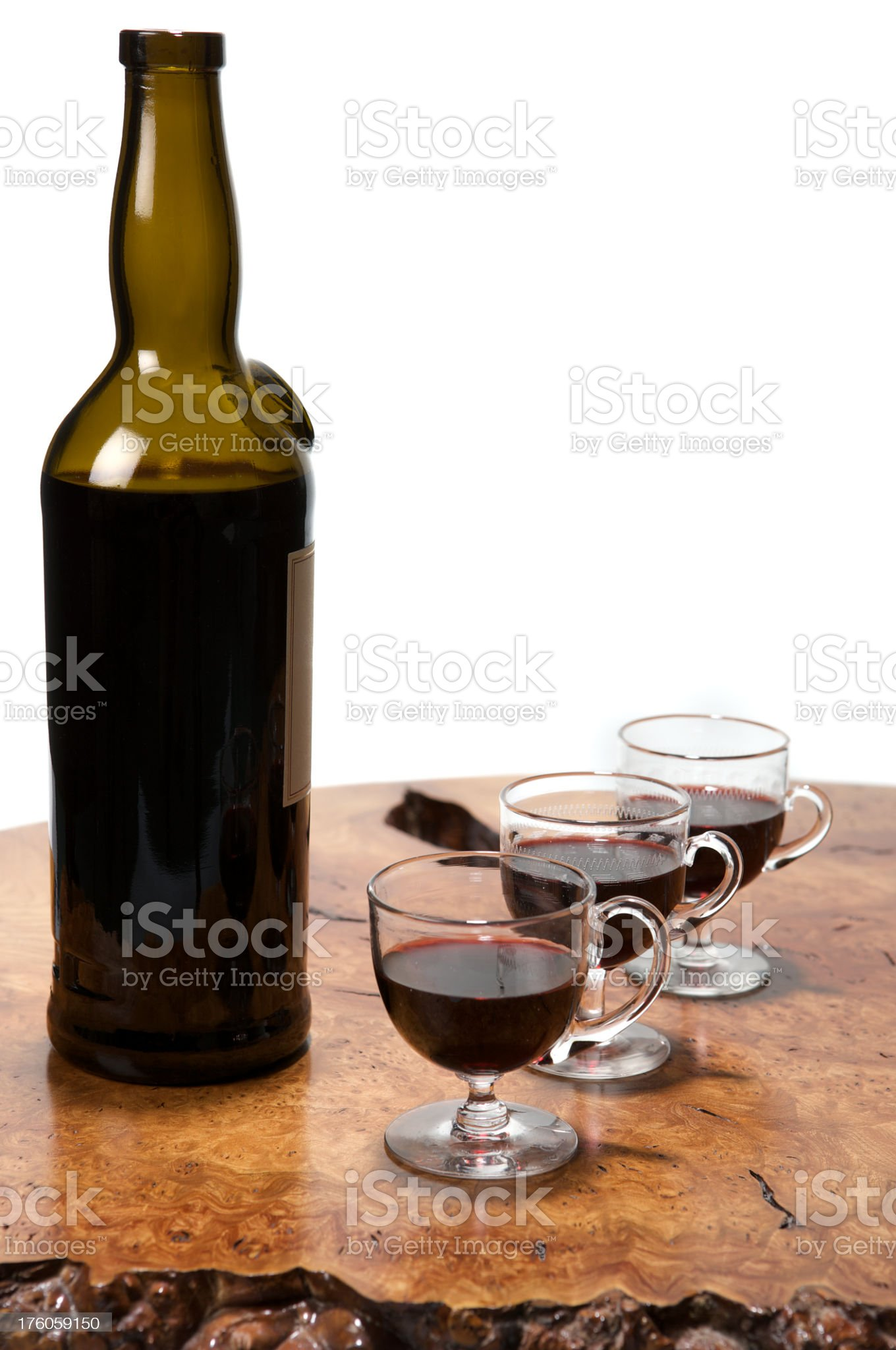 Three glasses of vintage port and bottle on wooden table royalty-free stock photo