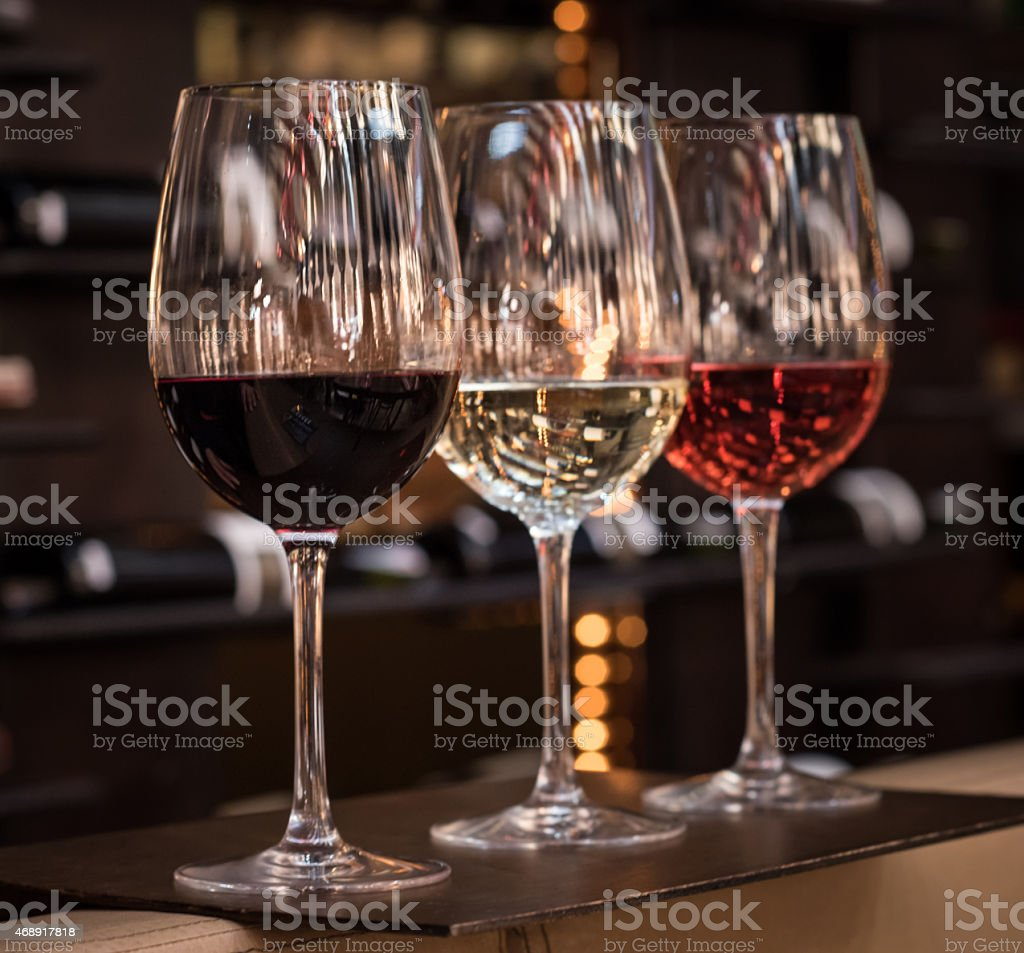 Three glasses of wine: red, white and rose stock photo