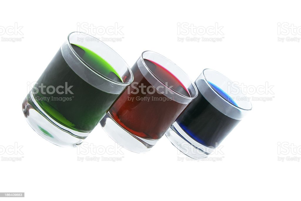 Three glasses with multi-coloured cocktails isolated over white royalty-free stock photo