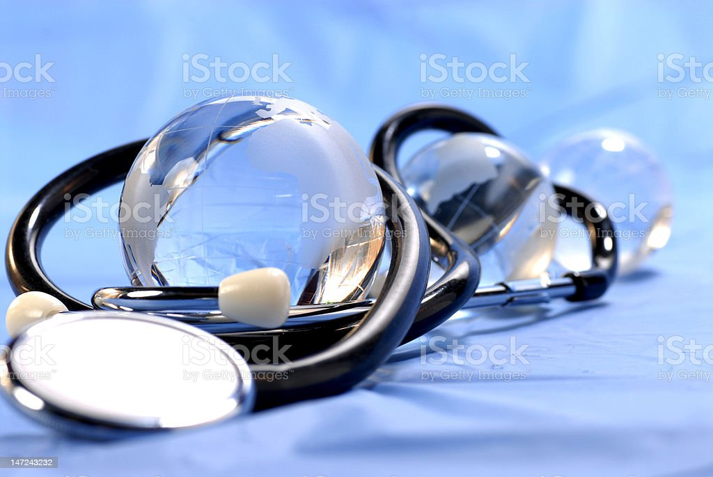 three globes and stethoscope royalty-free stock photo