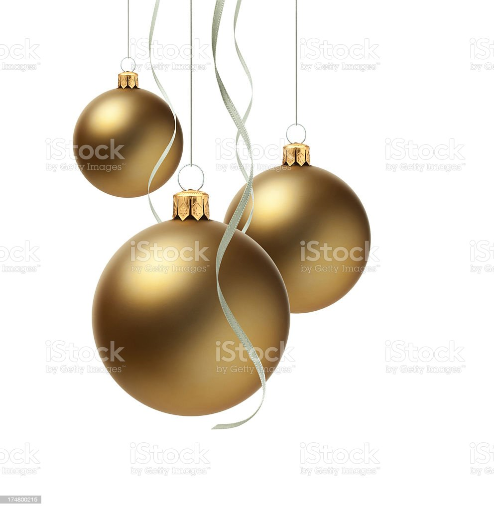 Three gold Christmas ornaments hanging on ribbon royalty-free stock photo