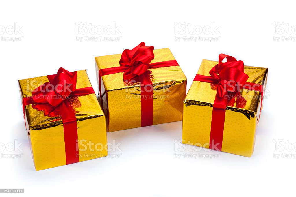 Three gold gift boxes stock photo