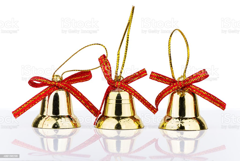 Three golden bell Christmas decorations with reflection stock photo