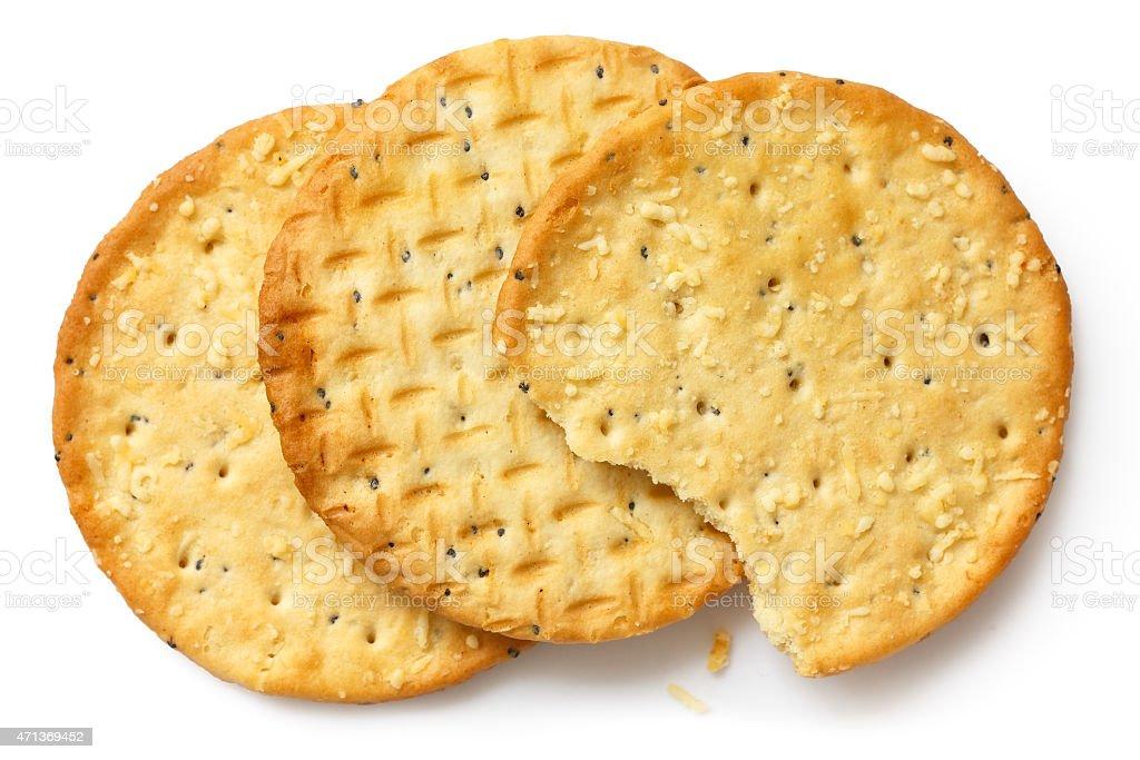Three golden cheese crackers on white. stock photo