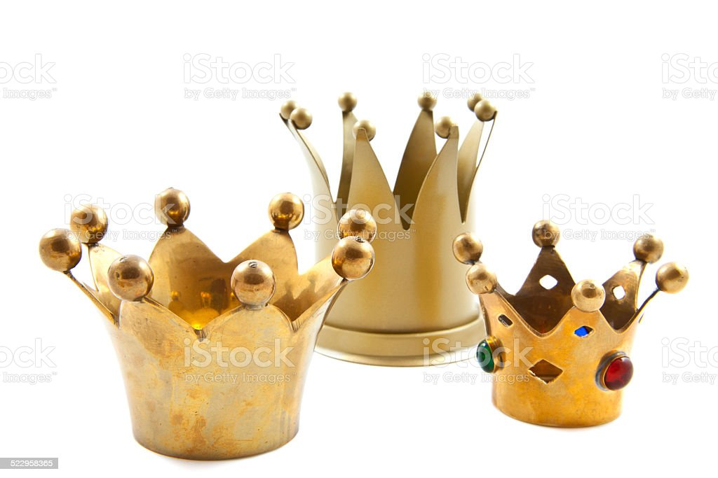 Three golden crowns stock photo