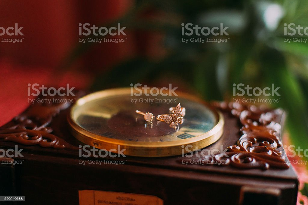 Three golden rings lie on the dial of old vintage stock photo