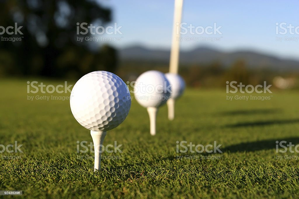Three golf balls in a row