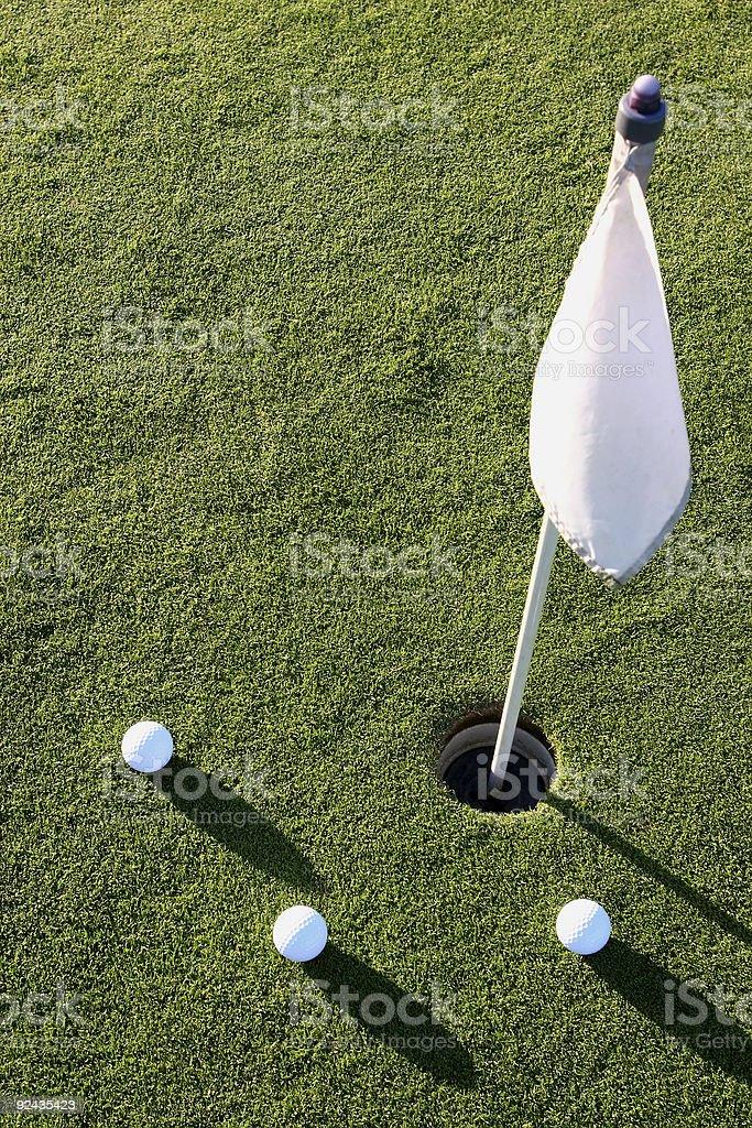 Three golf balls on the putting green royalty-free stock photo