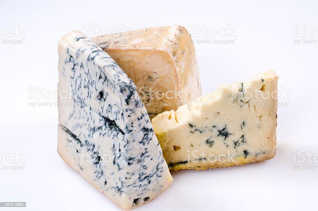 Three gorgonzola cheeses stock photo