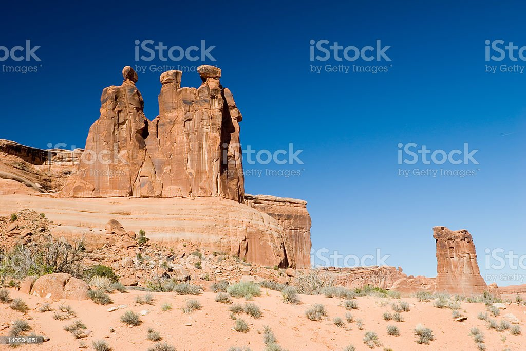 Three gossips and Sheep rock stock photo