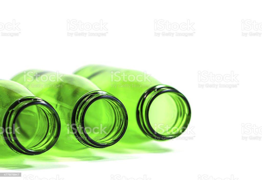 Three Green Bottles in White Background, focus on center bottle royalty-free stock photo