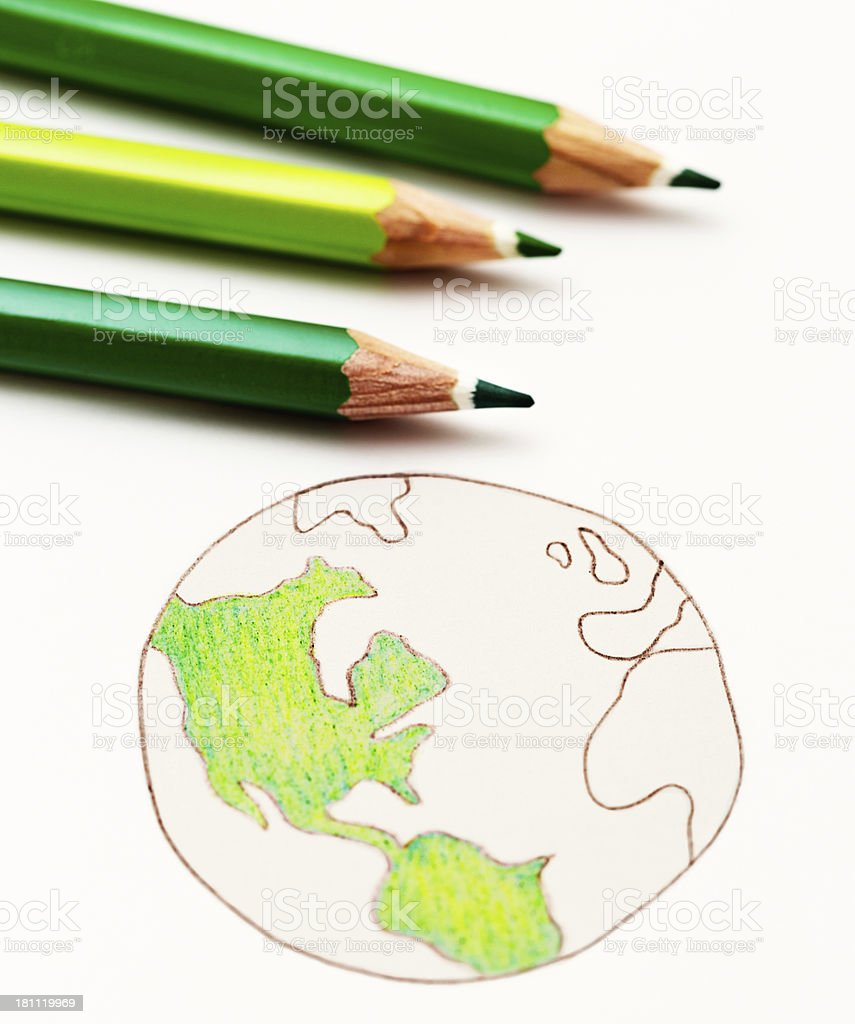 Three green pencil crayons colour in hand-drawn world map royalty-free stock photo