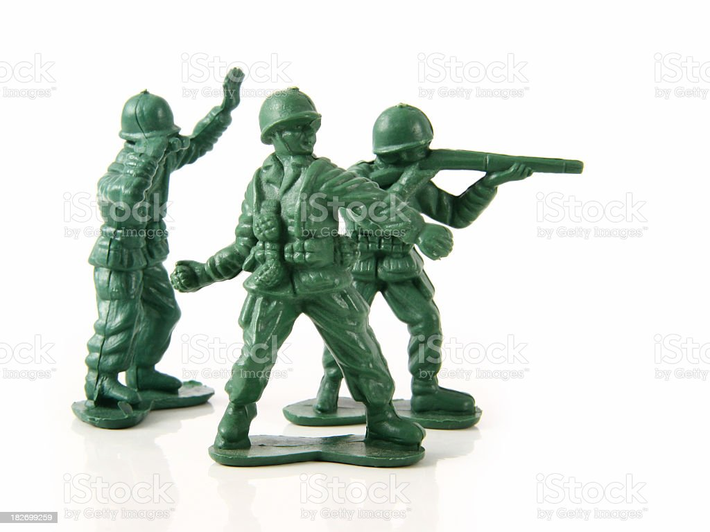 Three green toy soldiers dressed in their uniform stock photo
