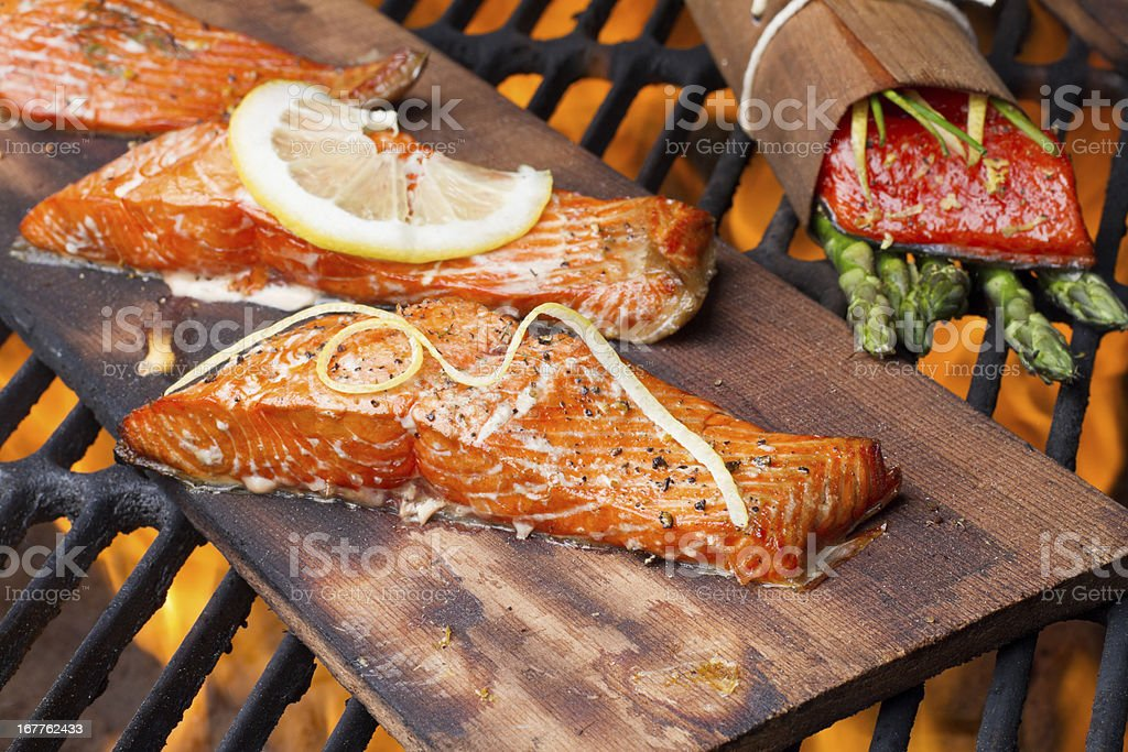 Three Grilled Salmon Filets on Cedar Plank stock photo
