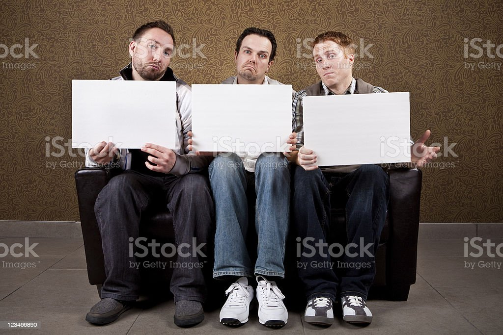Three guys rating the babes stock photo