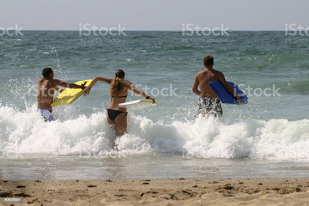 Three guys with bodyboard royalty-free stock photo