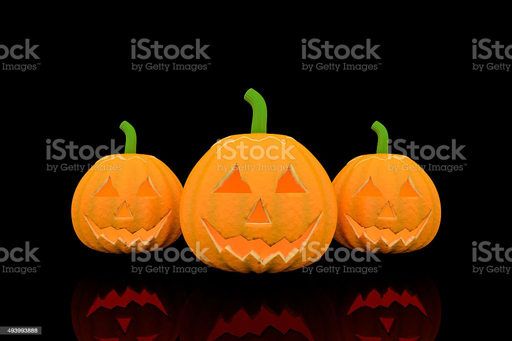 Three halloween pumpkins in black color background. royalty-free stock photo