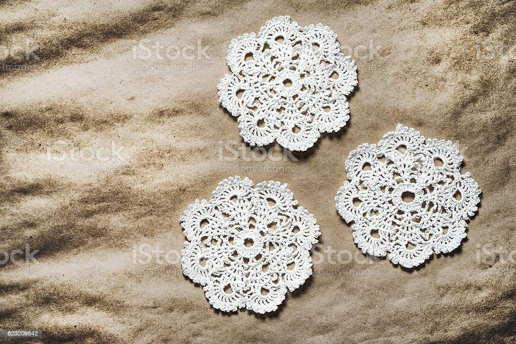 Three handmade white crochet doilies stock photo