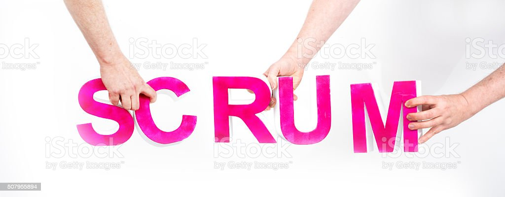 Three hands holding the word scrum stock photo