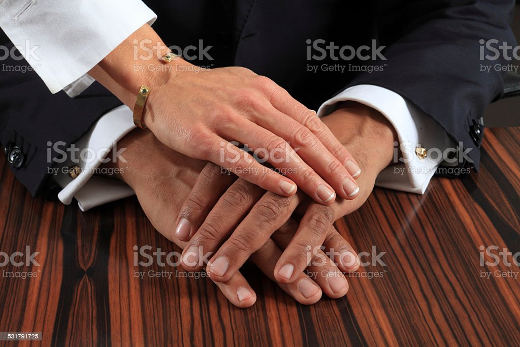 three hands over each other stock photo