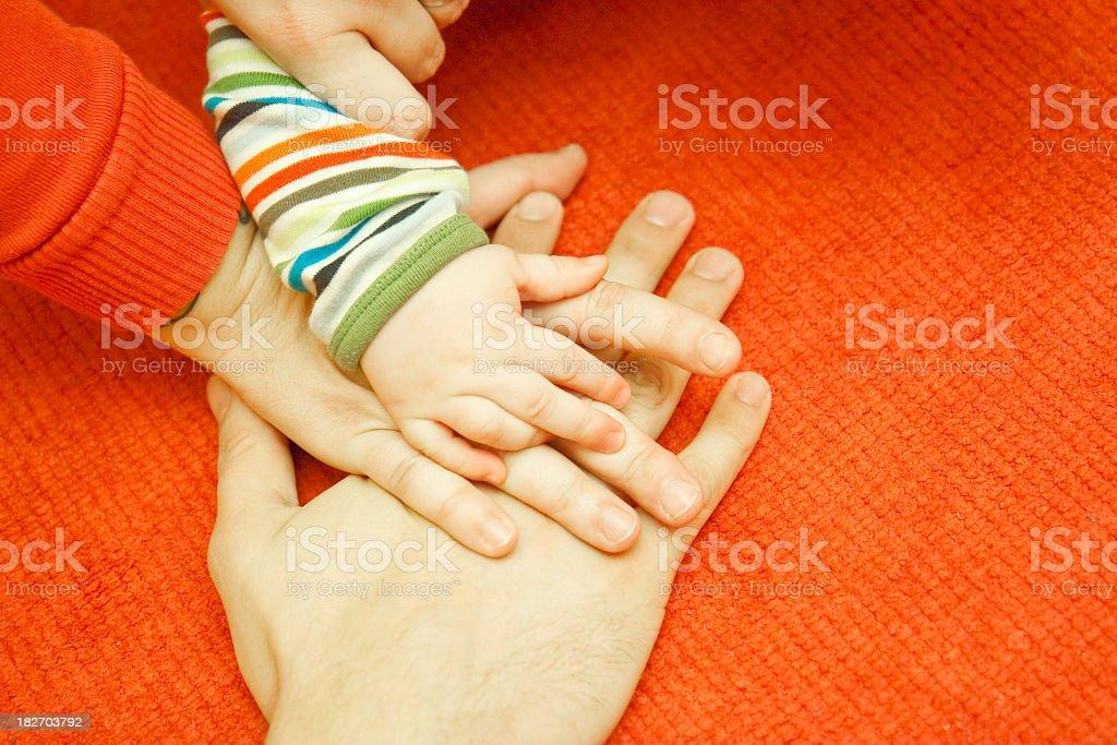 Three hands stock photo