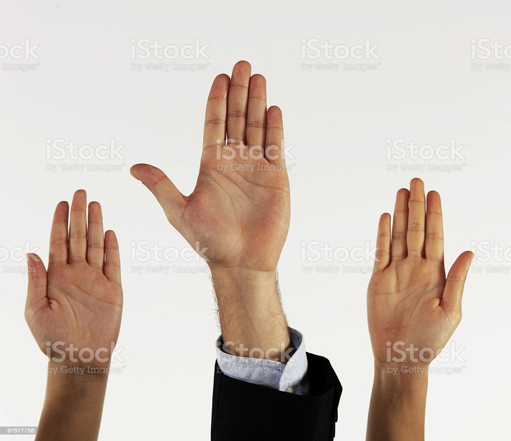 Three hands raised in the air with their fingers tight royalty-free stock photo