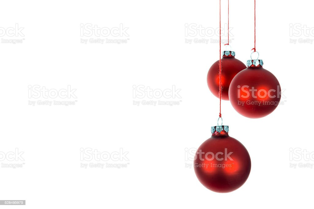 Three hanging Christmas balls at a white background stock photo
