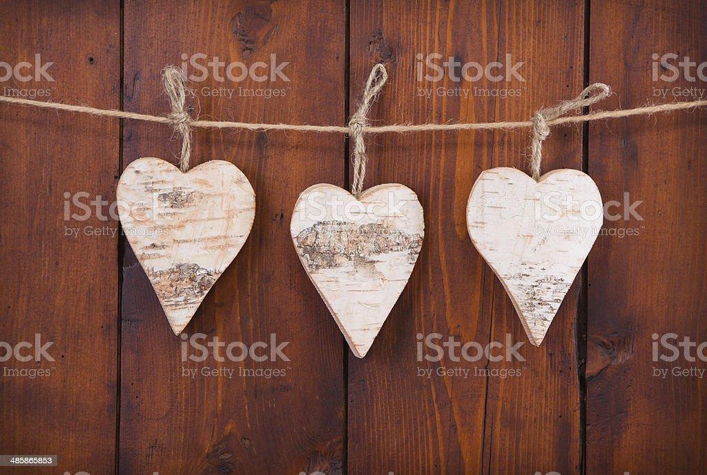 Three hanging wooden hearts. stock photo