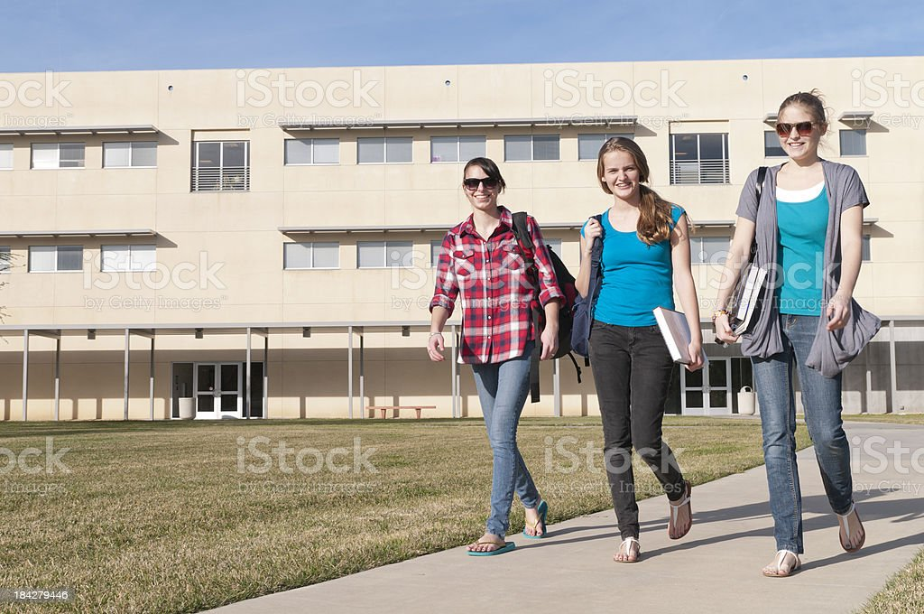 Three Happy, Casual Students Walking Together royalty-free stock photo