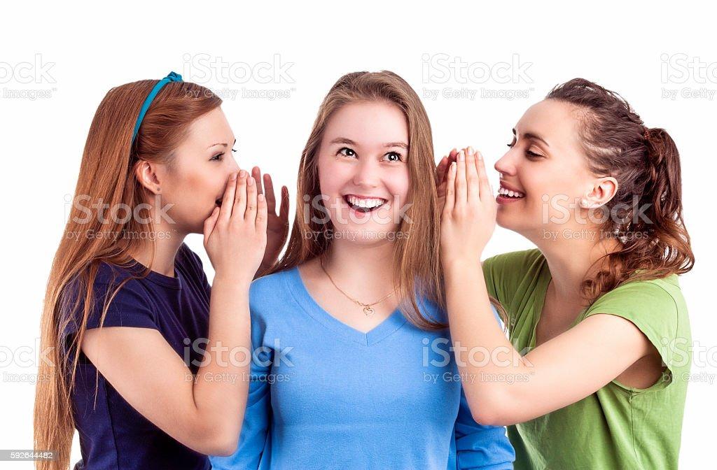 Three Happy Caucasian Females Sharing Secrets stock photo