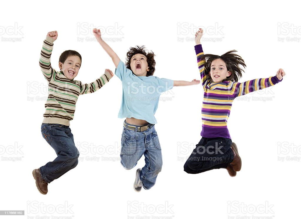 Three happy children jumping at once stock photo