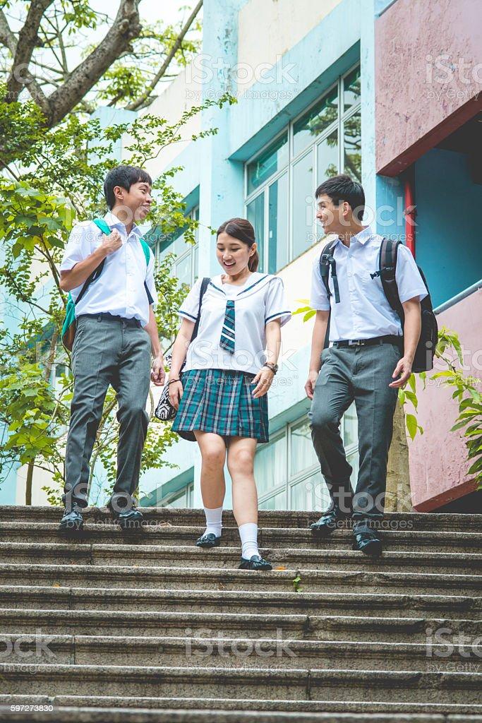 Three Happy Chinese Students in Campus, Hong Kong, China, Asia stock photo