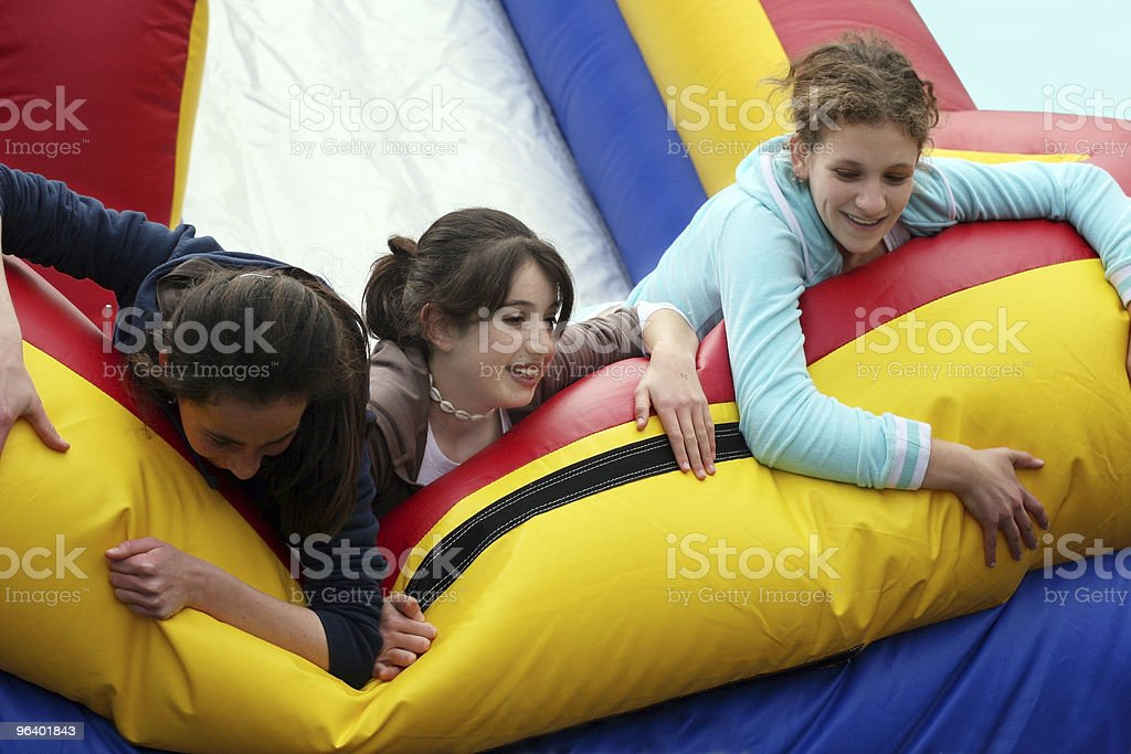 Three happy girl friends playing together royalty-free stock photo
