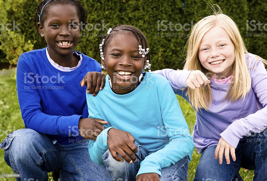 Three Happy Girls Together Outside royalty-free stock photo