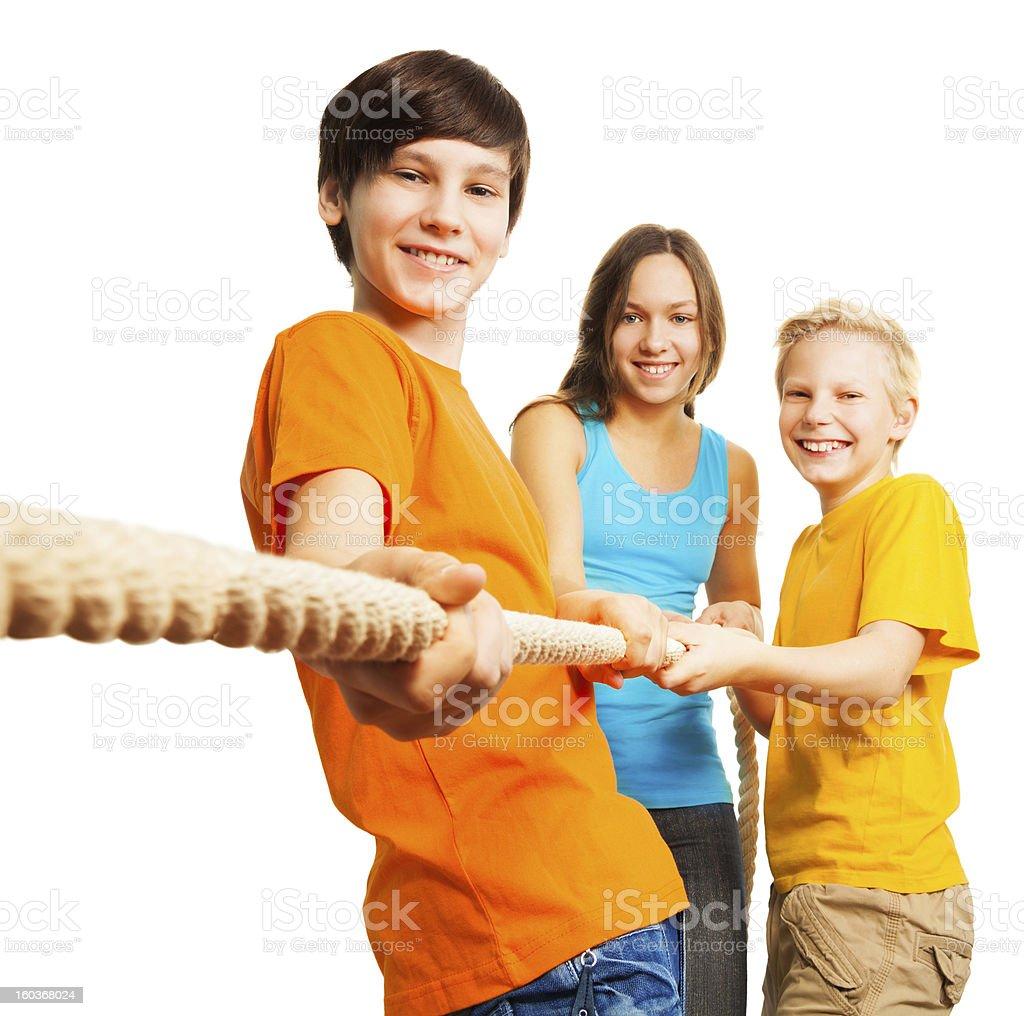Three happy kids pull the rope royalty-free stock photo