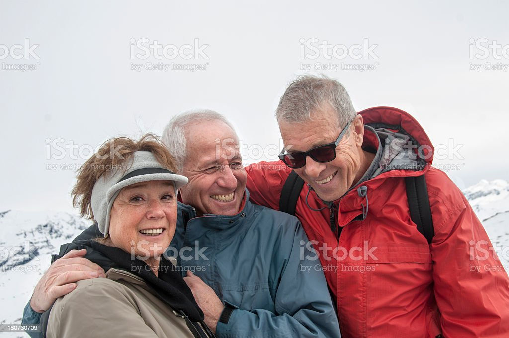 Three happy Seniors Having Fun During Winter Sport 2 royalty-free stock photo