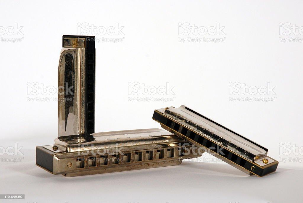 three harmonicas stock photo