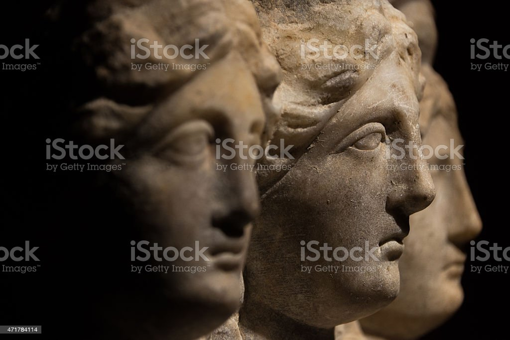 Three headed roman-asian ancient statue of beautiful women, Godd stock photo