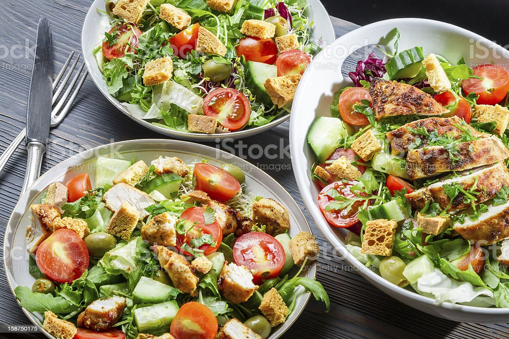 Three healthy salads with vegetables and chicken royalty-free stock photo